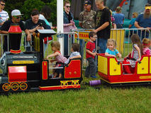 Children on the Fun-time Express. Moneta, VA, May 21th:  Children on the Fun-time Express children train carnival ride at the Scott's Farm Strawberry Festival Royalty Free Stock Photos