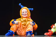 Children in funny colored overalls aliens  dancing on stage Royalty Free Stock Photography
