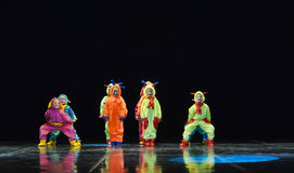 Children in funny colored overalls aliens  dancing on stage Royalty Free Stock Photo