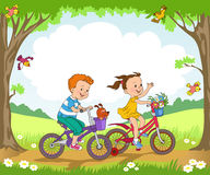 Children. Funny kids ride bikes along the forest summer day royalty free illustration