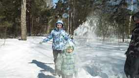 Children funs: snow is falling on a head stock video footage