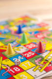 Children game with board and dice Stock Photography