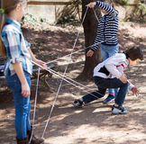 Children games. boy gently passes through the tangled rope Royalty Free Stock Photo