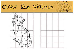 Children games: Copy the picture. Little cute baby tiger smiles. Children games: Copy the picture. Little cute baby tiger sits and smiles Stock Images