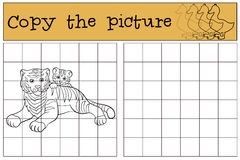 Children games: Copy the picture. Mother tiger lays with her baby Stock Photos