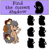 Children games: Find the correct shadow. Little cute hedgehog. Children games: Find the correct shadow. Little cute hedgehog stands with mushrooms in his Stock Photography