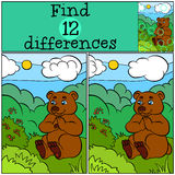 Children games: Find differences. Cute little bear. Children games: Find differences. Cute little bear sits on the grass in the forest and looks at the berries Royalty Free Stock Photos