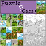 Children games: Puzzle. Little cute donkey. Children games: Puzzle. Little cute donkey stands on the field near the fence and smiles Royalty Free Stock Images