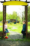 Children in the gate Royalty Free Stock Image