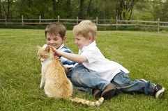 Children petting a cat Stock Photo
