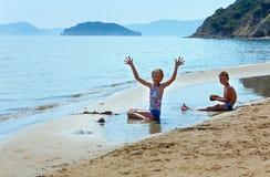 Children on Gerakas beach (Zakynthos, Greece) Stock Photo