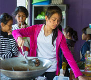 Children get food at lunch time at school by project Cambodian Kids Care to help deprived children in deprived areas on Koh Chang Royalty Free Stock Images