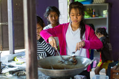 Children get food at lunch time at school by project Cambodian Kids Care to help deprived children in deprived areas on Koh Chang Royalty Free Stock Photography