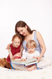 Children get a story read aloud. Young Mother and pretty child royalty free stock images