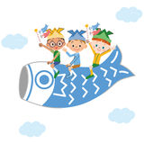 Children getting on the carp streamer Royalty Free Stock Photography