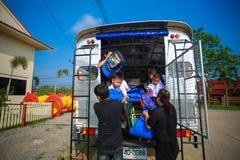 Children Getting off School Bus by teacher. Phrae Thailand - May 8, 2017: Children Getting off School Bus by teacher Royalty Free Stock Photography