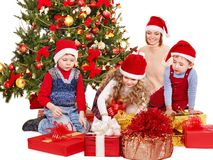 Children with gift box near Christmas tree. Royalty Free Stock Photo