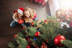 Children with gift under christmas tree stock photography
