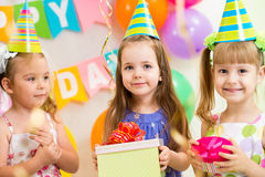Children with gifts on birthday party Royalty Free Stock Image