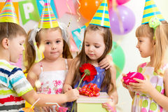 Children with gifts on birthday party Stock Photography