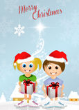 Children with gifts at Christmas Stock Photo