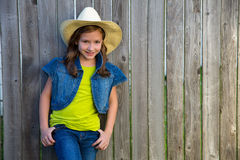 Children girl as kid cowgirl posing on wooden fence Royalty Free Stock Images