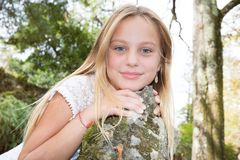 Children girl with blond long hair in white dress stock photos