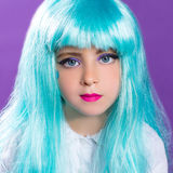 Children girl with blue turquoise long wig stock photos
