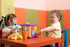 Children play before they see the doctor Stock Photography
