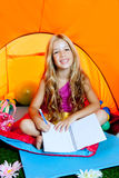 Children girl in camping tent with flowers Royalty Free Stock Photo