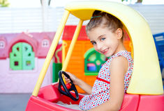 Children girl driving a toy car Royalty Free Stock Photos