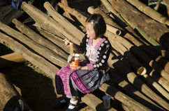 Children girl Ethnic Hmong wear costume traditional and sitting eat breakfast royalty free stock images