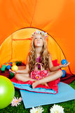 Children girl inside camping tent. Children girl in camping tent practicing yoga open arms and balls royalty free stock images