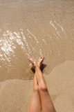 Children girl legs in beach sand shore Stock Photo