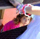 Children girl looking through slide stairway Stock Photography