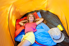 Children girl lying on camping tent. Floor in vacation stock photography