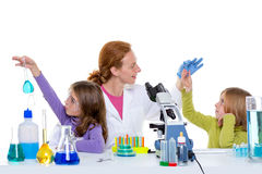 Children girlas and teacher woman at school laboratory Royalty Free Stock Photography