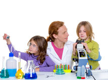 Children girlas and teacher woman at school laboratory Stock Images