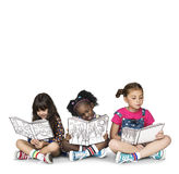 Children Girlfriends Reading Book Education Togetherness Studio. Portrait Stock Photo