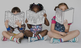 Children Girlfriends Reading Book Education Togetherness Studio. Children Girlfriends Reading Book Togetherness Studio Portrait Stock Image