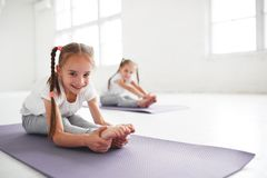 Children girls doing yoga and gymnastics in gym Stock Images