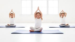 Children girls doing yoga and gymnastics in gym. Children girls doing yoga and gymnastics in the gym stock images