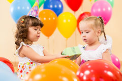 Children girls with gifts on birthday party Stock Photo