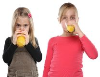 Children girls kids drinking orange juice healthy eating portrai. T format isolated on a white background Stock Photo