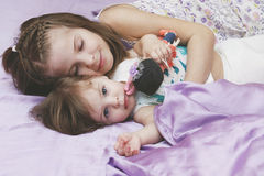Children girls lying in bed Royalty Free Stock Photography