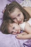 Children girls lying in bed Royalty Free Stock Image
