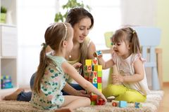 Children girls and mother playing together Stock Photos