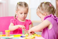 Children girls play with colorful clay Stock Images
