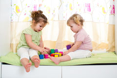 Children girls play together indoors Royalty Free Stock Image