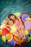 Children girls swim inner tube Royalty Free Stock Photo